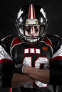 American football player with intense gaze portrait of Royalty Free Stock Images