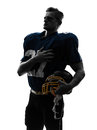 American football player man hand on heart silhouette one caucasian in studio isolated white background Royalty Free Stock Photo