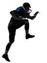 American football player man running silhouette one caucasian in studio isolated on white background Royalty Free Stock Photos