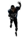 American football player man running silhouette one caucasian in studio isolated on white background Royalty Free Stock Photography