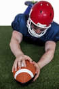 American football player scoring a touchdown determined on the field Stock Images