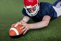 American football player scoring a touchdown determined on the field Royalty Free Stock Photos
