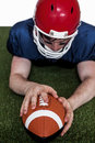 American football player scoring a touchdown determined on the field Stock Photo