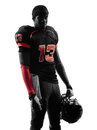American football player standing silhouette one in shadow on white background Stock Images