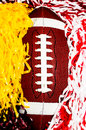American football and pom poms closeup of Royalty Free Stock Image