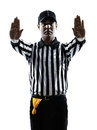 American football referee gestures silhouette in on white background Stock Photo