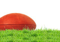 American football (rugby ball) on green grass over white Royalty Free Stock Photo