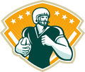 American football runningback crest illustration of an gridiron player running with ball set inside shield done in retro style Stock Photos