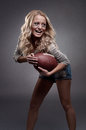 American football woman beautiful girl holding a ball for Stock Photos