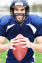 American footballer holding ball portrait of football player Royalty Free Stock Photography