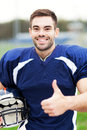 American footballer showing thumbs up portrait of football player Royalty Free Stock Photo