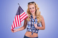 American girl caucasian woman holding flag on blue gradient background Royalty Free Stock Image
