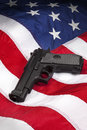 American gun laws law hand on the flag of the united states of america Royalty Free Stock Photos