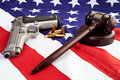 American gun laws photo of gavel and bullets over an flag Stock Images