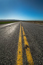 American highway horizon, lonely road and field. Royalty Free Stock Photo