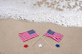 American holidays background on the sandy beach near the ocean Stock Images