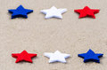 American holidays background with stars on the sand Stock Photography