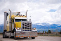 American icon of style customized yellow semi truck rig Royalty Free Stock Photo