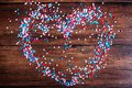 American Independence day background with blue, white and red mixed stars in the shape of heart. Celebration the 4th of July the Royalty Free Stock Photo