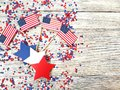 American independence Day, celebration, patriotism and holidays concept - flags and stars on the 4th of July party on top on woode Royalty Free Stock Photo