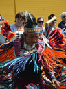 American indian in full dress this colourful traditional is undertaking a rain dance with on lookers photo taken april Royalty Free Stock Photography