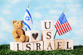 American israel friendship a toy bear sitting on alphabet blocks arranged on a bed of grass to say and usa a heart shape and an Stock Images