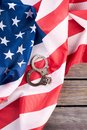 American justice handcuffs on flag, top view. Royalty Free Stock Photo