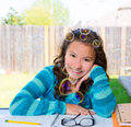 American latin teen girl doing homework on backyard with soap bubbles Stock Image