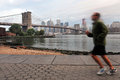 American man runs near the Brooklyn Bridge Royalty Free Stock Photo