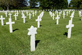 American military war cemetery rows of white crosses receding into distance brittany france Stock Images