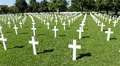 American military war cemetery rows of white crosses receding into distance brittany france Royalty Free Stock Image