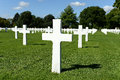 American military war cemetery rows of white crosses receding into distance brittany france Stock Photo