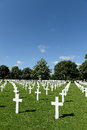 American military war cemetery rows of white crosses receding into distance brittany france Stock Photos