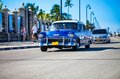 American oldtimer in cuba drive on the street havana malecon Stock Image