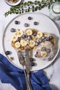 American pancakes with blueberries and bananas. Top view shot. Royalty Free Stock Photo