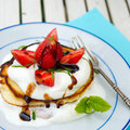American pancakes with cream balsamic and fresh strawberries Royalty Free Stock Photography