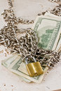 American paper money with a silver chain and a closed gold lock Royalty Free Stock Images
