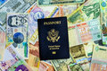 American passport and currency with various latin currencies Royalty Free Stock Images