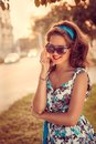 American redhead girl in suglasses. Photo in 60s style. Royalty Free Stock Photo