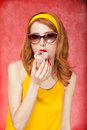 American redhead girl in sunglasses with cake. Stock Photos