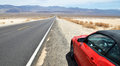 American road and car in Death Valley Royalty Free Stock Photo