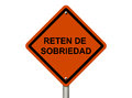 An american road warning sign isolated on white with words reten de sobriedad in spanish checkpoint stop drinking and driving Stock Photography