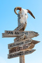 American signpost western with goat skull to famous us landmarks Royalty Free Stock Photo