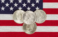 American silver dollars and usa flag closeup view of united states dollar coins placed on Stock Image