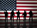American special forces with an flag background Royalty Free Stock Image