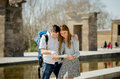 American student and tourist couple reading city map in tourism concept Royalty Free Stock Photo