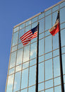 American and Texas flags in front of building Royalty Free Stock Photo