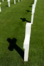 American war graves closeup of white world two casting shadows on green grass brittany france Stock Photo