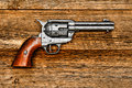 American west legend peacemaker revolver on wood old style antique six shooter weapon gun aged board Stock Photos
