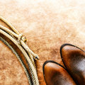 American West Rodeo Cowboy Boots and Lasso Lariat Stock Photos